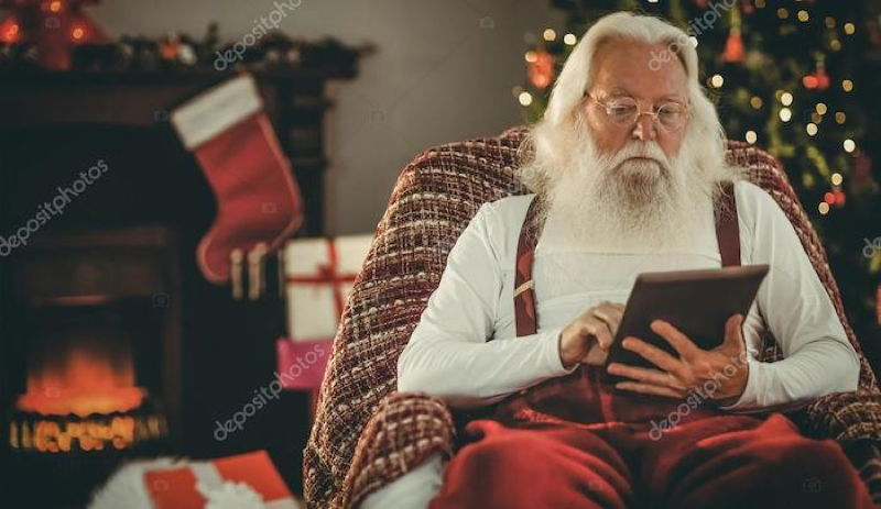 depositphotos_88728056-stock-photo-santa-claus-using-tablet-on.jpg
